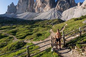 Male hiker below the mountain