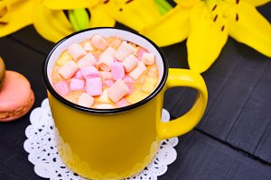 Cocoa drink in a yellow mug