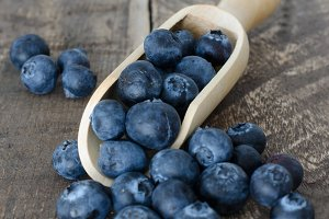 Blueberries with wooden spoon