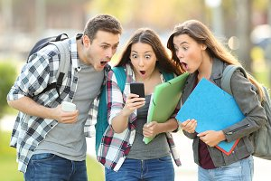 Three amazed students