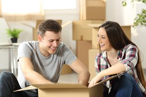 Couple moving home packing