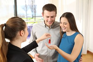 Happy couple receiving the keys