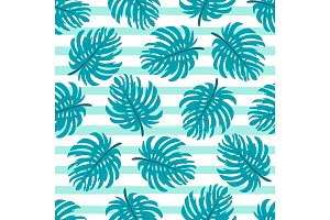 Cute seamless pattern with tropical palm leaves