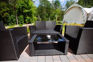 Black wicker outdoor seating area