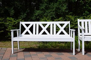 White Wooden Benches in the park