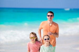Family on white tropical beach have a lot of fun