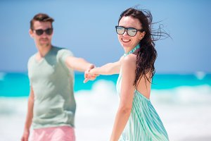 Happy young couple in honeymoon on the beach enjoy romatic vacation