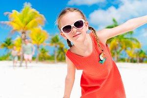 Closeup of adorable little girl during beach vacation having fun