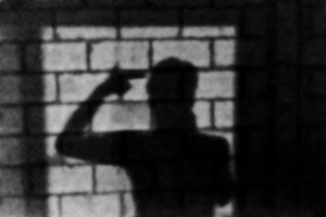 Man Silhouette at Brick Wall