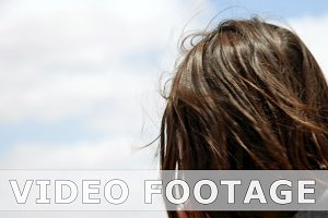 Longhair woman with flying hair outdoors