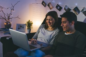Young Couple using computer