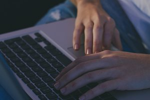 Closeup of woman hand using computer