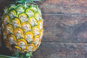 pineapple fruit on wood table
