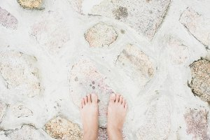 Barefoot on cement stone floor