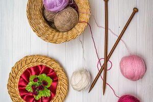 Balls of yarn on a wooden board