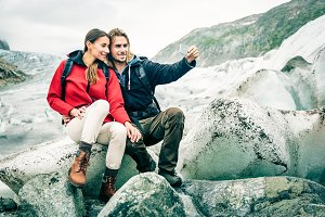 Young Couple Hiking In The Swiss Alps, Taking A Selfie