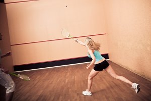 Young People Playing Squash At The Gym