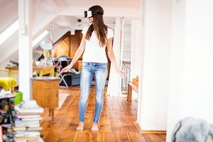 Young Woman In Her Apartment, Using Vr Glasses