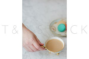 Woman Holding Coffee Cup Macarons