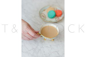 Woman Hand Coffee Cup & Macarons