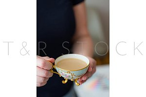 Woman Holding cup of Milk and Tea