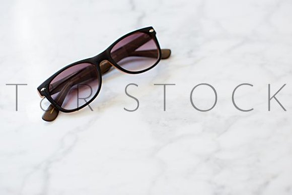 Marble Desktop Sunglasses Flat Lay