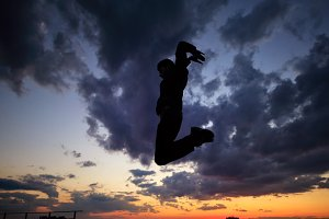 Silhouette of man on roof. Parkour