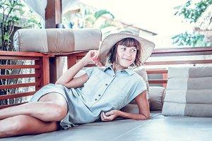 Beauty enjoying her summer vacation at luxury villa. Summer holiday idyllic. Bali island, Indonesia.