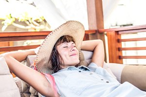 Beauty enjoying her summer vacation at luxury villa. Summer holiday idyllic. Bali island, Indonesia.