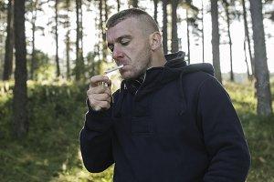 Boy who smokes a cigarette