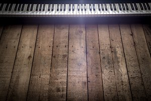 piano on wooden background closeup