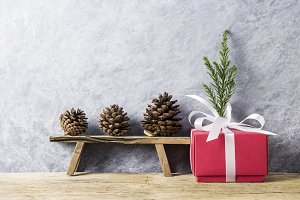 Red gift box and pine cone