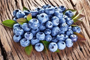 Blueberries over old wood