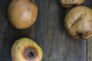 Rotten apples on wood
