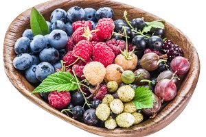 Berries in the wooden bowl.