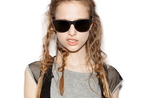 Fashion girl hipster with sunglasses