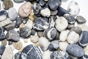 Sea pebbles on a white background