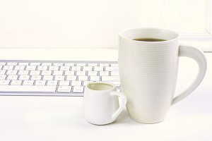 Desktop with creamer and coffee