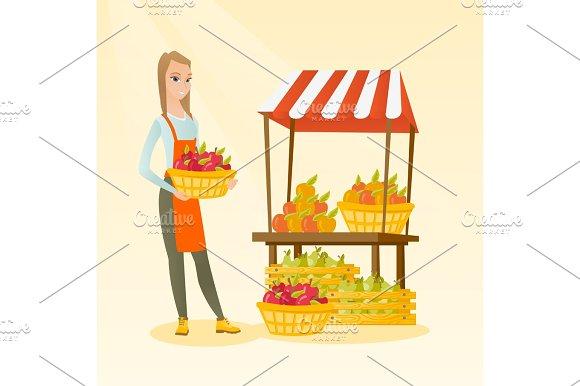 Greengrocer Holding Box Full Of Apples