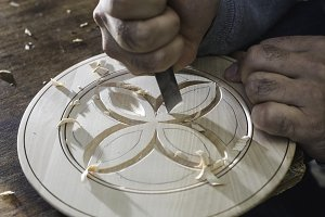 Woodcarver makes threaded plate