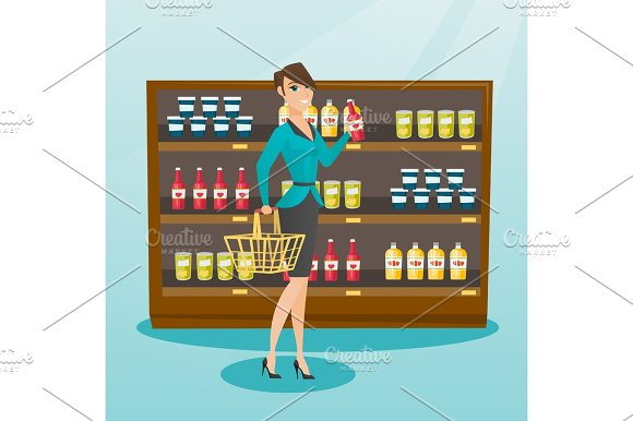 Woman Holding Shopping Basket And Bottle Of Sauce