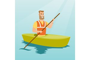 Young caucasian man travelling by kayak.