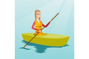 Young caucasian woman travelling by kayak.