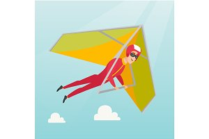 Young caucasian man flying on hang-glider.