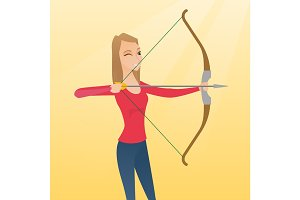 Young caucasian archer training with a bow.