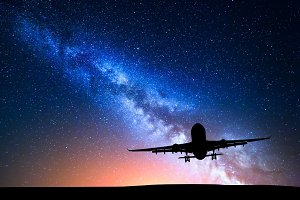 Milky Way and silhouette of a airplane