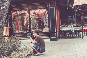 BALI, INDONESIA - JUNE 30, 2017: Asian street photographer making shots, Bali island.