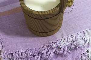 Vintage wooden cup of milk