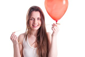 Girl with red balloon heart