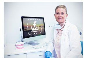 Dentist On Computer At Desk Mockup